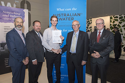 Luke Greenbank (centre) with award sponsors from the Water Directorate to his right and AWA to his left
